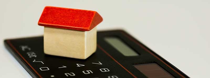 miniature house on a calculator